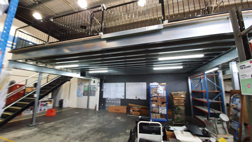 Example of mezzanine floor dividing space into additional floor space.